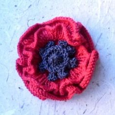 "FREE on Ravelry by Katy Sparrow who says, ""Poppy flower pattern knitted in the round on shor dpns with layered petals and decorative centre. Knitted Poppy Free Pattern, Knitted Flower Pattern, Knitted Poppies, Crochet Poppy, Poppy Pattern, Knitted Flowers, Knitting Patterns Free, Knit Patterns, Free Knitting"