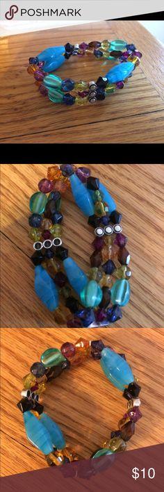 Lia Sophia Bracelet Beautiful, colorful bracelet by Lia Sophia. Elastic is in great condition. Never been worn or stretched. Lia Sophia Jewelry Bracelets