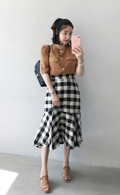 Get this look: http://lb.nu/look/8770937 More looks by Miamiyu K: http://lb.nu/miamiyu Items in this look: Miamasvin Half Sleeve Button Down Blouse, Miamasvin Gingham Check Ruffled Hem Midi Skirt #summerfashion #koreanfashion #chic #streetstyle