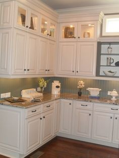 White Kitchen Cabinets make a small kitchen look larger | cabinet trim, gray green and