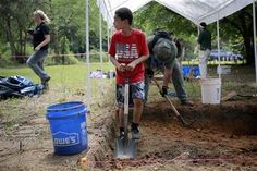 Bones unearthed in search at former Florida reform school. Bill Cottrell//Jason Due-Barnes,9, helps University of South Florida researchers exhume a grave at the Boot Hill cemetery at the now closed Arthur G. Dozier School for Boys in Marianna, FL.
