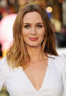 Brunette British actress Emily Blunt in a white dress