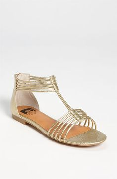 "One of ""THE"" trends this spring:  gold metallic flats."