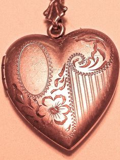 ~1930s Chased Gold Heart Locket - the asymmetry is so fun