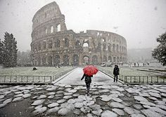 Snow in Rome!  Love the Red umbrella!  thank you: http://anamericaninrome.com/wp/tag/snow-in-rome/