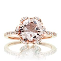 Absolutely beautiful feminine morganite ring, set in solid 14k rose gold with dazzling white diamonds and an 8mm round morganite. This lovely engagement ring is adorned with a pinkish morganite, round cut, accented with genuine diamond half way down the shank. Morganites are in the beryl family, cou