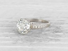 Early Art Deco engagement ring set with a 2.99 carat old European-cut diamond with GIA certificate stating the diamond is K color/SI1 clarity, with single-cut diamond shoulders. Set in platinum.Circa 1920. We love this ring's romantic sentiment of subtly detailed heart motifs on the platinum filigree basket. Diamond and gold mining has caused devastation in areas such as Africa, wreaking havoc on delicate ecosystems and communities. Choosing to go vintage, you are eliminating the ...