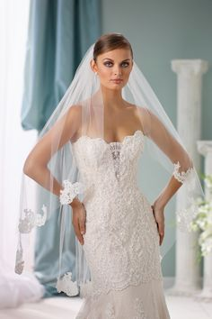 Scattered lace veils give the lace look without being overwhelming.  Perfect with any lace dress.