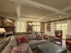 Family and library space flanked by custom millwork. #design #msd #poconomanor #familyroom #library #coffered #millwork