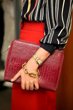 Gold Cartier watch, DVF for H. Stern gold bracelet, and simple gold wedding band