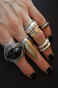 (Loves) I really love big chunky silver rings (this pic looks like a mix of gold and silver, still cool)...I'm digging the silver bands on the upper ring finger, nice.