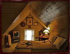 Cozy wood-paneled attic room.