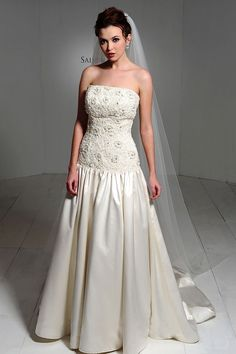 strapless dropped waist ball gown with delicate lace bodice beaded throughout with appliqued flowers. graceful skirt finishes with a chapel train. timeless yet modern and totally elegant.  from Saison Blanche Couture.