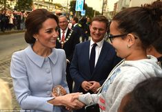 The Duchess looks delighted as she chats to local youngsters in Rotterdam and is handed an...