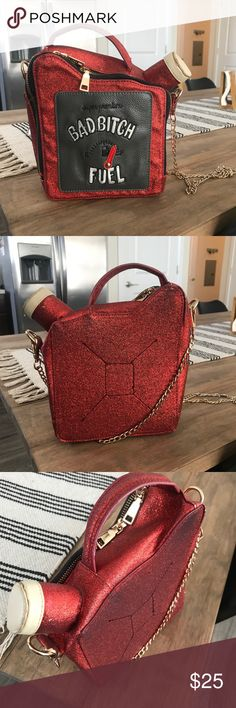 """Small novelty purse with chain Red glitter handbag shaped like an oil can that says """"bad bitch fuel""""   Perfect for all my fellow baddies.  It's a little worn but still in great condition. I've used it a handful of time and always get compliments.   Comes with long chain, easily rocked as a crossbody. SHEIN Bags Crossbody Bags"""