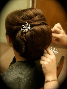 I liked their site  Hair ~ Updo » Wedding Tresses » On Location Beauty Services in Boston » Boston, MA