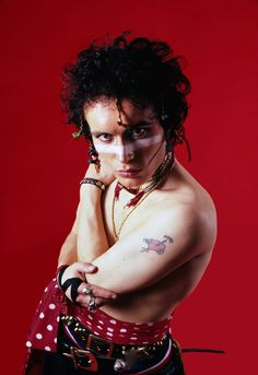 """worlocked: """" [colour photo: shirtless Adam Ant in full war paint shows off his 'ADAM' tricep tattoo."""