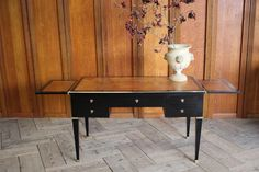A fine quality and with elegant proportions, mid 20th century French ebonised bureau plat / desk with two brushing slides, in the Louis XVI taste, retaining the original polished brass mounts. Antique Desk, Antique Furniture, Louis Xvi, Brushing, Polished Brass, French Antiques, 1940s, Entryway Tables, Mid Century