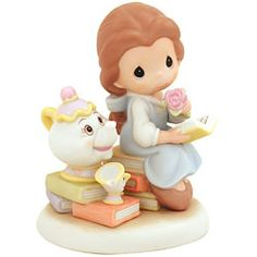 Rare Disney figurines - This rare Goebel-Hummel Minnie and Mickey figurine is patterned after the classic Hummel figures of a boy and girl standing under an umbrella.