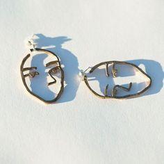 Beautiful face shape earrings. Only 8€.