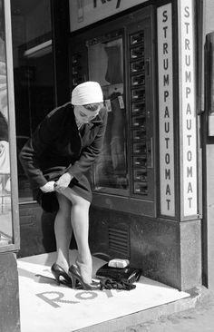 A woman hikes up her new nylons in Stockholm, Sweden, c.1956