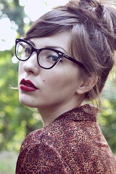 Red lips, glasses, and leopard print - via Keiko Lynn.