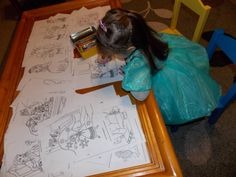 Printed out Princess coloring pages and put it on the coffee table.