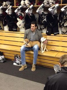 Pittsburgh Penguins: Evgeni Malkin with puppies