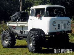 Jeep FC-170 / COE w/ custom built bed, don't know what's cooler, the truck or the canine co-pilot with shades