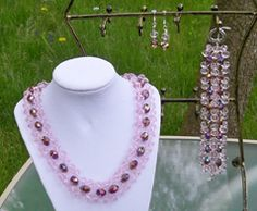 clear pink woven necklace, double bracelet and earrings