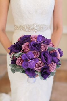 Purple orchids and roses: http://www.stylemepretty.com/little-black-book-blog/2014/05/07/modern-las-vegas-wedding/   Photography: Meg Ruth - http://megruth.com/
