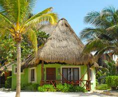 Colorful individual villas in Playa del Carmen. Beachfront Mexican Caribbean.