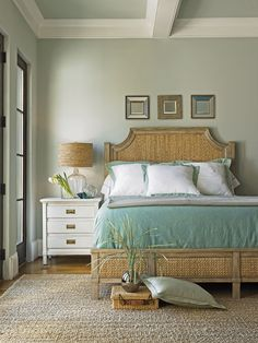 beachy bedroom - beach theme.  love the nightstand and mirrors above the bed.