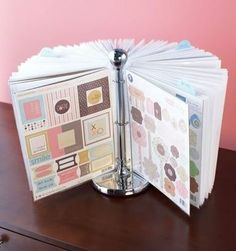 Paper towel holder, binder rings, and page covers = a great way to display kids artwork, or favorite recipes... The possibilities are endless! - LOVE this idea.