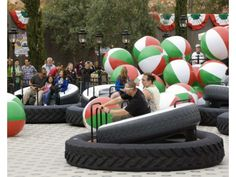 Annual passholders float across the surface on air on the Luigi's Flying Tires attraction that is part of Cars Land at Disney California Adventure.