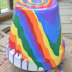 Rainbow Pour Painting {Craft Ideas for Home}  So want to try this.  Anyone want to play with paint and pots.
