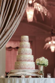 Tiered cake with pink design: http://www.stylemepretty.com/little-black-book-blog/2013/10/29/new-england-lawn-club-wedding-from-melani-lust-photography/ | Photography: Melani Lust - http://www.melanilustphotography.com/