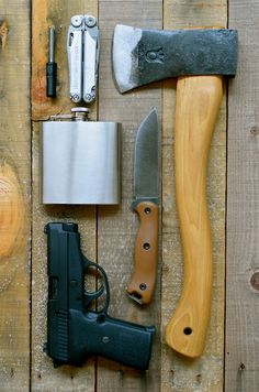 Hostile Planet: Essential Items Needed for Disaster Preparation; fire steel, multi-tool, hatchet, whiskey, quality fixed blade knife, & a pistol.