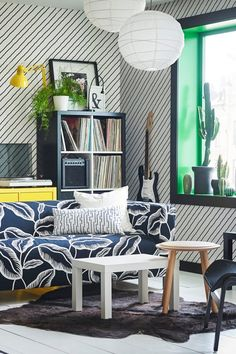 Hosting tip: Bright colors and patterns can turn any area of your living room into a conversation piece. Click to browse IKEA living room furniture, textiles and rugs that will wow your guests.