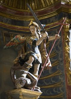 Polychrome statue of St Michael defeating the devil in St Nicholas' church in Segovia, Spain. Today, 29 September, is the feast of the archangels.