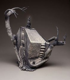 On The Bridge – Chris Theiss 1989.  Slab and coil built earthenware with sgraffito.