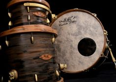 SJC Custom Drums - wonderful dark wood grain pattern - similar to walnut. Lighter wood rim trim. One of my favorite drumkit photos - different from most. Enlarge to see details. RESEARCH #DdO:) among MOST POPULAR RE-PINS in 12 weeks: http://www.pinterest.com/DianaDeeOsborne/drums-drumming-joy/ - DRUMS AND DRUMMING JOY. SJC hand crafts their drumset pieces to the customer's personal order using their Virtual Designer Kit. Check the Look Book tab! Interesting pin I'm glad I found via…