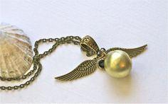 Harry Potter Font Golden Snitch Always Necklace Steampunk. $29.00, via Etsy.
