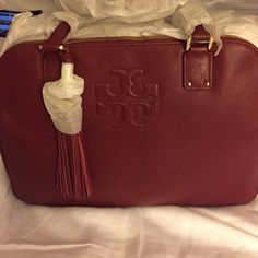 """Tory Burch Handbag Tory Burch Thea Triple Zip (Large) Satchel New w/tags. Color: Dark Cherry. Gold hardware. Hanging tassel. Pebbled leather. Measurements: 10 1/4"""" H x  14"""" W x 4"""" D. Includes Tory Burch Dust bag.Excellent Condition. PRICE FIRM. 🚫No trades. Tory Burch Bags Satchels"""