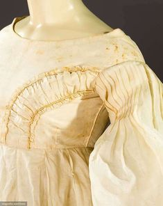 Late 1830s white organdy gown.