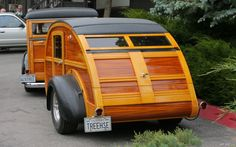 Beautiful teardrop trailer and woody.