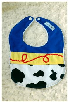 This cowboy/cowgirl baby bib is perfect for Woody and Jesse fans!!  DETAILS:  Is backed with a super soft white minky fabric, one of the highest