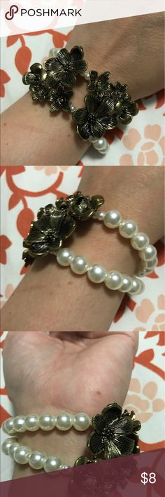 Pearl bracelet with gold floral accent One size fits all....gold floral design with two strands of pearls on the back.  Super cute!!!! Charlotte Russe Jewelry Bracelets