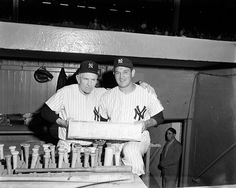Yankees manager Casey Stengel (left) and Reynolds holding the game's commemorative pitching rubber in front of New York's dugout. Today, the autographed artifact can be seen on the National Baseball Hall of Fame and Museum.