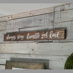 Always stay humble and kind Rustic Wooden Sign  Wood sign is stained in color of your choice (samples in pictures).  Note: The color stain in the default picture is dark walnut. The lettering is white.  Size is 21 x 4 x 1 thick  Letters are hand painted in color of your choice(samples in pictures).  Please select your stain and lettering color in the drop down tabs.  Sealed with a matte polycrylic. 2 small pre-drilled holes in back for optional hanging.  I am also selling a larger version of…